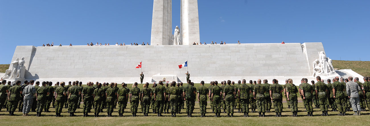 Vimy Ridge with Canadian Soldiers standing at attention
